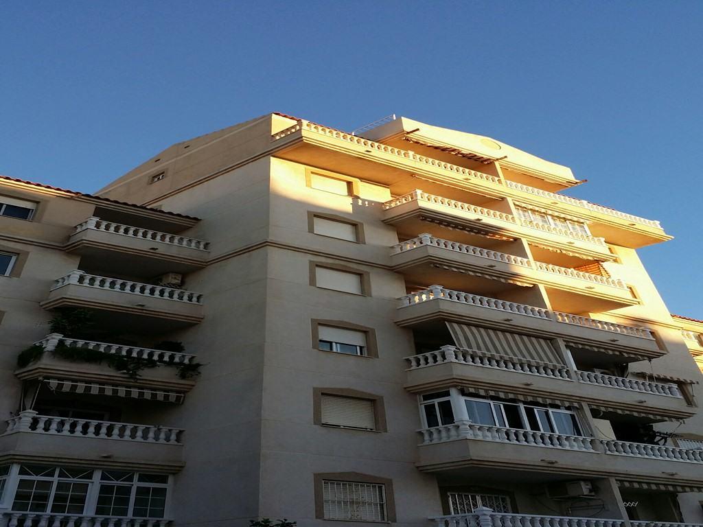 Апартаменты с двумя спальнями в городе Торревьеха с бассейном, Южная сторона